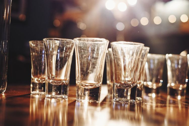 Glasses are ready for liquor Glass - Material Drinking Glass Table Drink Food And Drink Transparent Still Life Alcohol Close-up Bar - Drink Establishment Lens Flare Glass Focus On Foreground Reflection In A Row Brightly Lit Restaurant Freshness Bar Counter Arrangement
