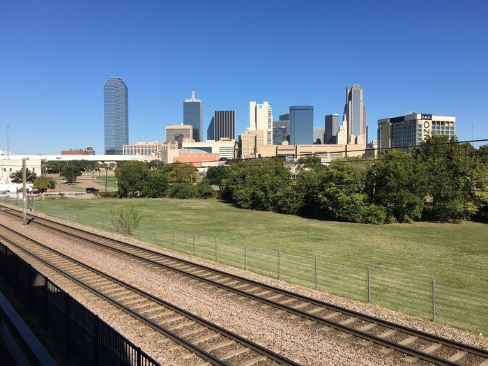 Dallas Dallas Tx Dallas Skyline Clear Sky No People Railroad Track Rail Transportation Urban Skyline Urban Landscape Building Exterior Lush Foliage Afternoon City Day Highrise Tall Buildings Sunlight Copy Space Open Space Tower Tall - High Landscape Blue Sky Skyscraper Architecture Outdoors Building