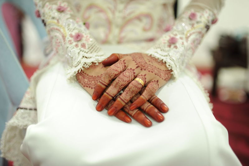 Close-Up Of Bride Sitting On Chair During Wedding