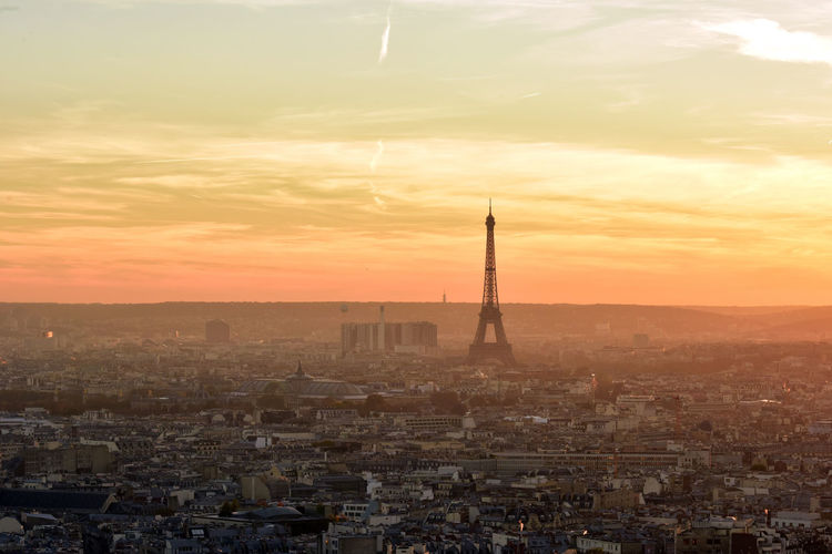 Mid distance view of silhouette eiffel tower against sky during sunset