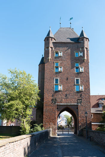 XANTEN, GERMANY - SEPTEMBER 07, 2016: The historic city tower with its city gate is a landmark and attractive for tourists A Blue Sky Castel Cathedral Downtown Germany History Medieval Photography Place To Visit Roman Tour Touristic Attratio Xanten
