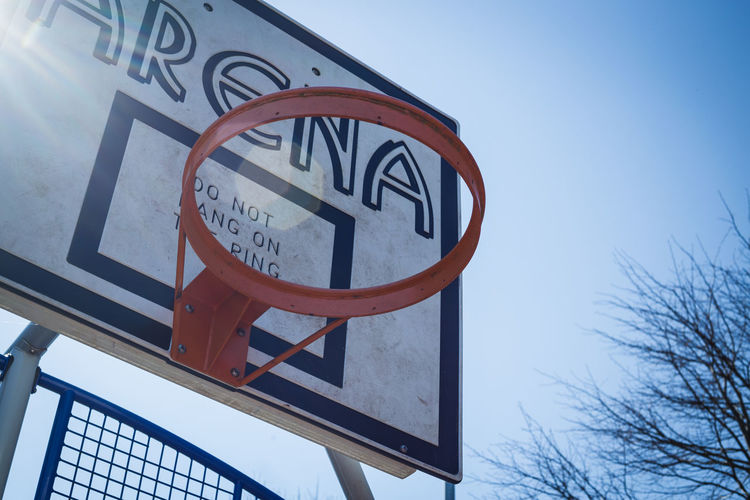 Basketball Architecture Blue Built Structure Clear Sky Close-up Day Low Angle View Nature No People Nostalgia Outdoors Sign Sky Springtime Sunshine Western Script Visual Creativity