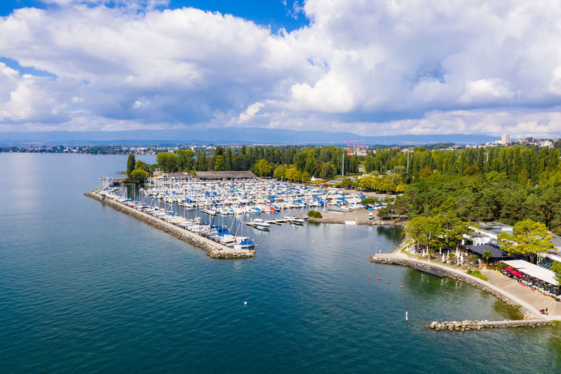 High angle view of marina and sea against sky
