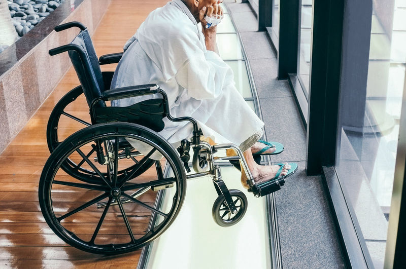 Medical Equipment Wheelchair Healthcare And Medicine Differing Abilities Real People Indoors  People Sitting Men Hospital Architecture Physical Impairment Adult Lifestyles Transportation Low Section Casual Clothing Wheel Care Elderly Medical Check Up Healthcare