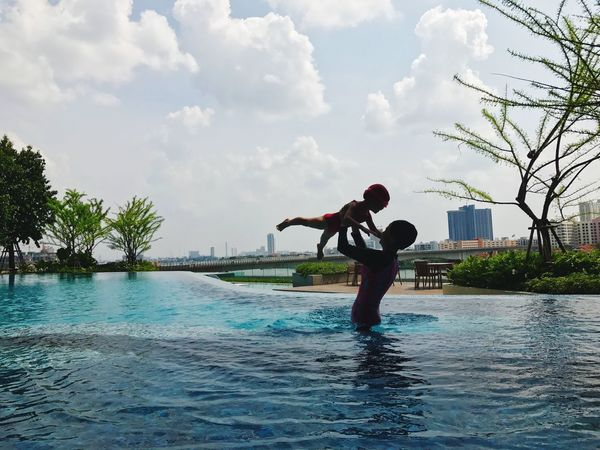 Mum And Daughter Mummy And Baby Mummy And Daughter Mummy Love  Mather And Daughter Mather&baby Water Sky Swimming Pool Tree Cloud - Sky Real People Day Enjoyment Waterfront Happiness Vacations