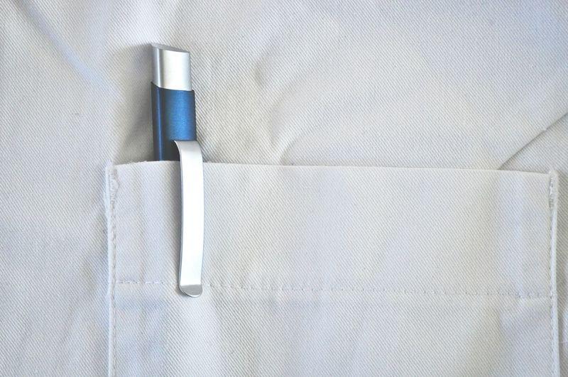 Close-up of pen in shirt pocket