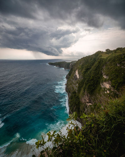 few minutes before thunderstorm at kelingking beach, nusa penida, indonesia Sea Sky Water Scenics - Nature Beauty In Nature Cloud - Sky Tranquil Scene Nature Land Horizon Horizon Over Water Tranquility No People Non-urban Scene Beach Day Idyllic Outdoors