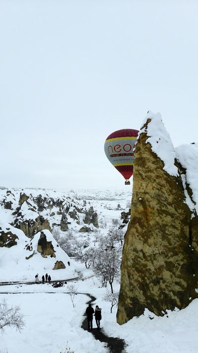 Balloon Balloons In The Sky Balloontrip Fairycave Cold Temperature Snow Winter Outdoors Sky Nature No People Day Snowing Cappadocia/Turkey