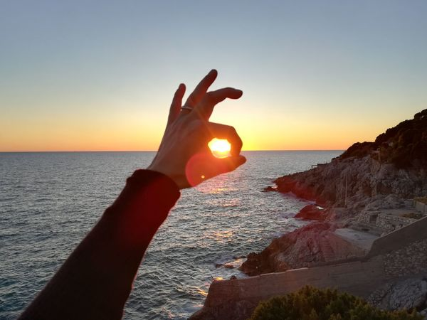 Park Circeo Beach Human Body Part Human Hand Sea Sunset Horizon Over Water Hand Nature People Travel Destinations One Person Sun
