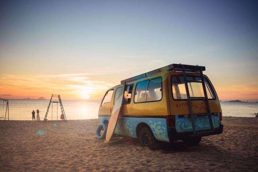 sunrise over the beach with old van and surfboard. Sky Beach Sea Sand Horizon Horizon Over Water Tranquility Travel Outdoors Summer Summertime Vacation Vietnam NhaTrangbeach NhaTrang Sunrise Old Car Surfboard Gold Sand