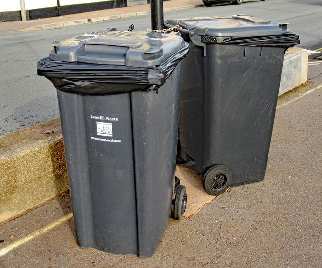 Garbage bin on street in city