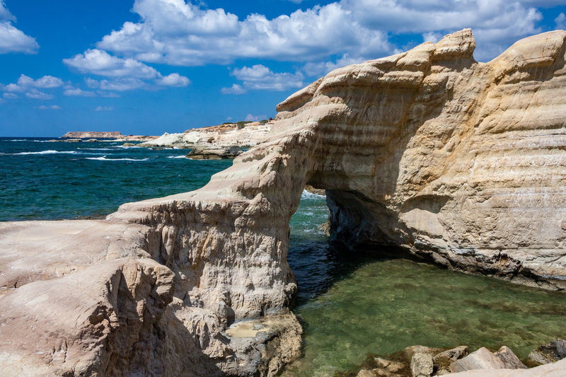 Natural arch near Peyia Arch Beauty In Nature Cloud - Sky Day Horizon Over Water Natural Bridge  Nature No People Outdoors Peyia Rock - Object Scenics Sea Sky Sunlight Tranquility Water
