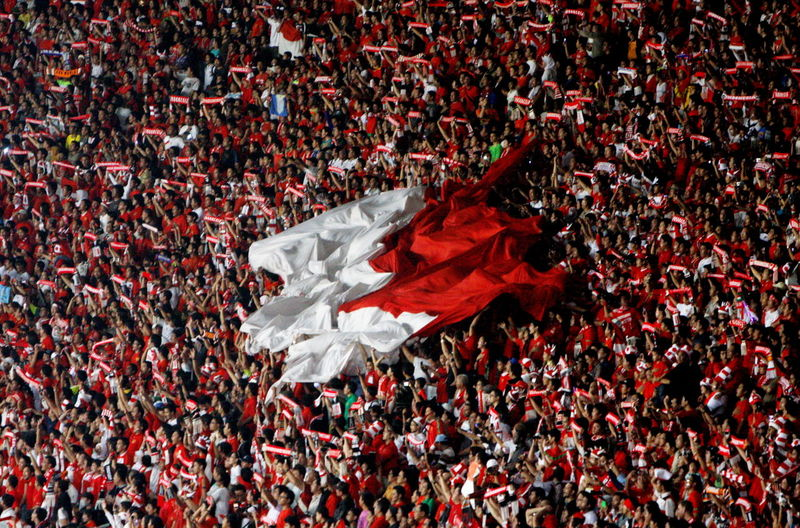 Spectators With Indonesian Flag In Soccer Stadium