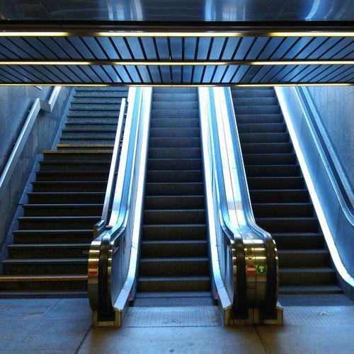 Low angle view of escalator at subway