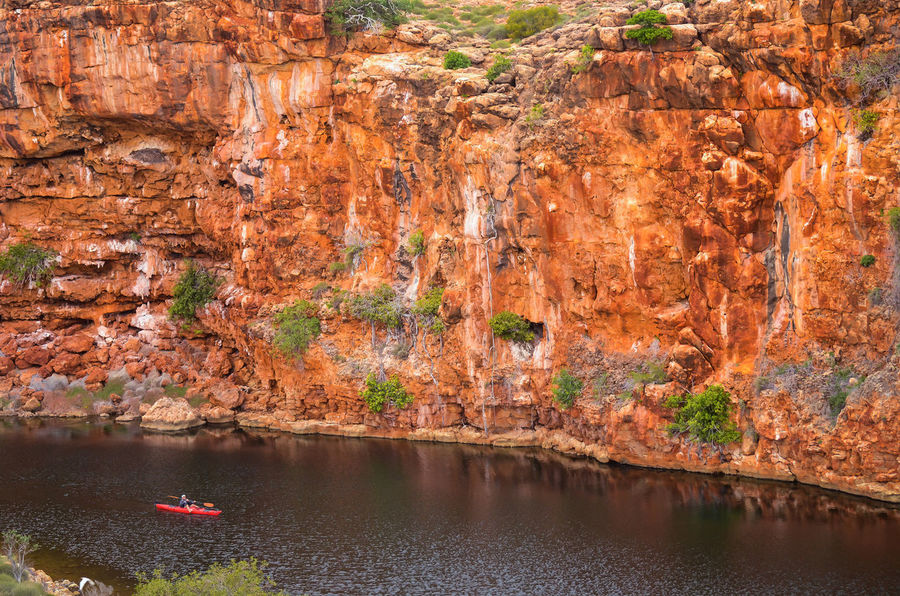 Exploring Yardie Creek near Exmouth in Western Australia Australia Canoe Canoeing Cliffs Exploring Kayaking Rowing Western Australia Yardie Yardie Cr Yardie Creek Adventure Cliff Exmouth  Kayak Nature Nautical Vessel Orange Color Outdoors Red Cliffs River Rock - Object Rock Formation Stream Water