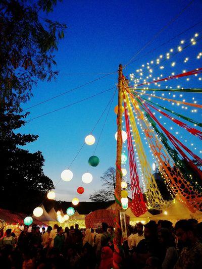 The Calicut Flea market. Celebration Night Low Angle View Illuminated Tree Blue Outdoors Arts Culture And Entertainment Sky