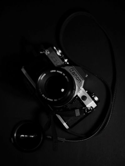 Camera - Photographic Equipment Technology Photography Themes Indoors  Digital Camera No People Close-up Studio Shot Camera Sound Recording Equipment Old-fashioned Movie Camera Black Background