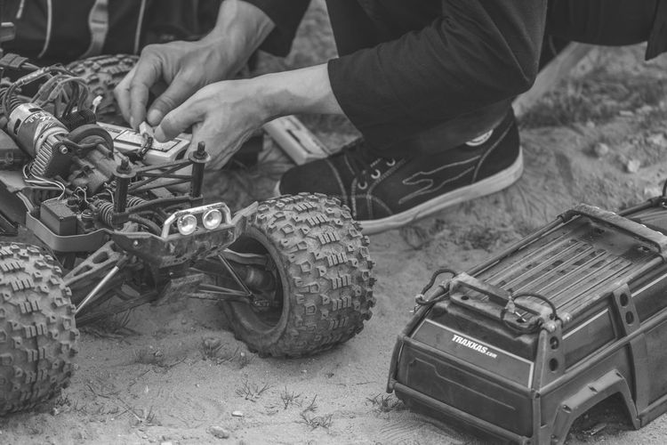 RC Techie / Power & Metal Series Body Part Car Day Focus On Foreground Garage Human Body Part Human Foot Human Leg Land Land Vehicle Low Section Mechanic Men Mode Of Transportation Motor Vehicle One Person Outdoors Real People Repairing Technology Tire Transportation Wheel Small Business Heroes