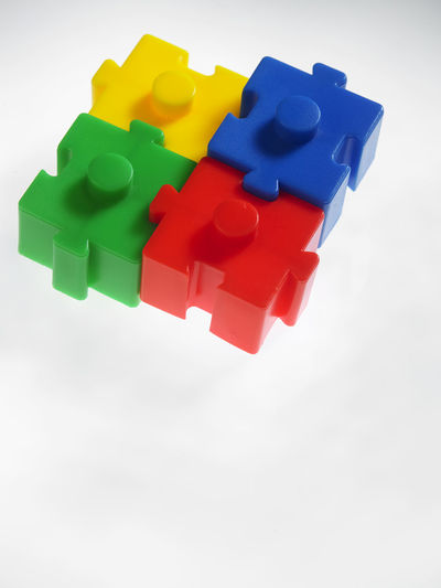Close-Up Of Multi Colored Toy Against Gray Background