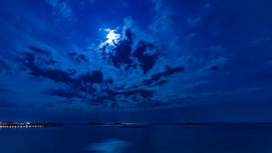 Idyllic shot of sea against blue sky at night