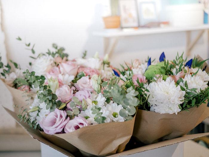Close-up of flower bouquets at florist atelier