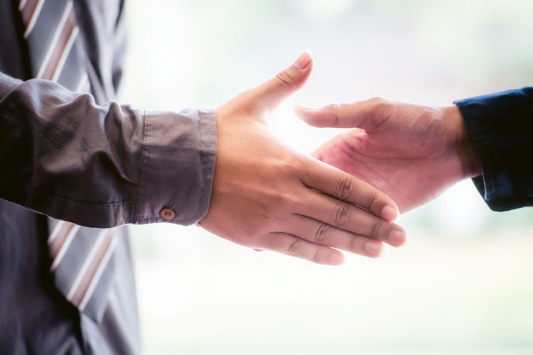 Adult Agreement Bonding Business Cooperation Coworker Day Finger Focus On Foreground Hand Handshake Human Body Part Human Hand Men Partnership - Teamwork People Positive Emotion Real People Teamwork Togetherness Two People