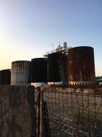 Urban Old Factory Tanks Built Structure Building Exterior Storage Tank Industry No People Outdoors Sky City Fence