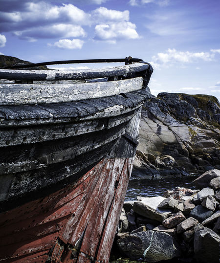 Beauty In Nature Boat Cloud - Sky Day Nature No People Non-urban Scene Old Outdoors Rock Rock - Object Scenics - Nature Ship Sky Solid Stern Tranquil Scene Tranquility Water Winter Wood Wood - Material The Still Life Photographer - 2018 EyeEm Awards