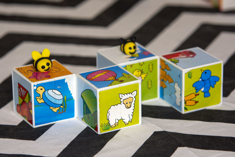 Toy No People Representation Focus On Foreground Close-up Sunlight Still Life Day Art And Craft Multi Colored Creativity Toy Block Human Representation Yellow Architecture Outdoors Shadow Box Leisure Games