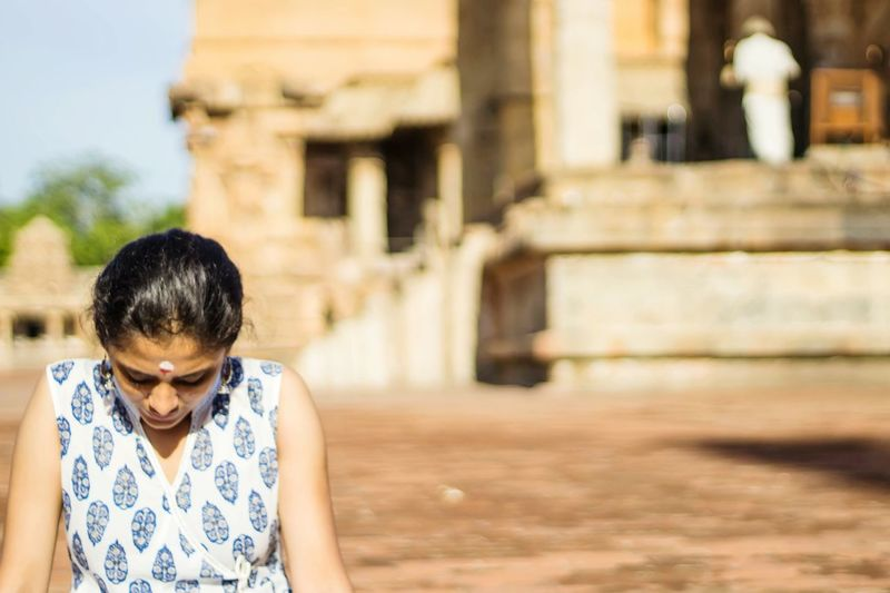 EyeEm Selects Meditation One Woman Only Day Adult One Person Sitting In The Sun Outdoors Temple - Building Peace Of Mind Tranquil Scene Young Adult EyeEm Gallery Tanjore_big_temple