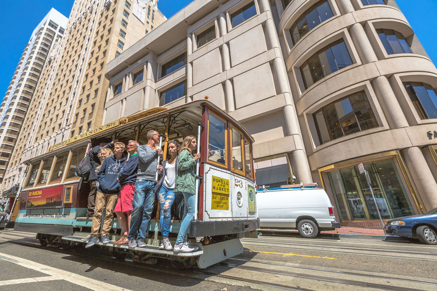 San Francisco, CA, United States - August 17, 2016: crowds of tourists in the popular Union Square, the central square of San Francisco on Market Street, known as the place shopping and luxury hotels. San Francisco, California, United States - August 17, 2016: the Big Bus, Hop On Hop Off, Sightseeing Tour, the popular double-decker bus carrying tourists, standing in Union Square, during a day tour. Cable Car California Market SF San Francisco Square Union Union Square SF United States Adult Architecture Building Exterior Built Structure Car City Day Friendship Full Length Land Vehicle Leisure Activity Low Angle View Market Street San Francisco Market Street Men Mode Of Transport Outdoors People Real People Sky Street Togetherness Transportation Union Square  Unionsquare Women Young Adult Young Women