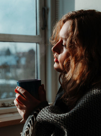 Woman drinking coffee in cup