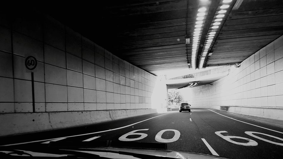 Illuminated The Way Forward Road Tunnel Built Structure Architecture Sports Race No People Neon Day Black And White Photography Blackandwhitephotography Blackandwhitephoto Random Acts Of Photography Sixty Speed Limit Sign EyeEm Selects