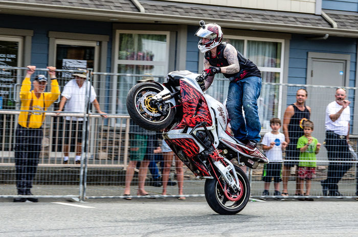 A Wheelie Down Main Street Architecture Art Art And Craft Awesome Bicycle Building Exterior Built Structure City Cumberland Cute Full Length Hanging Mode Of Transport Motorcyle Multi Colored Outdoors Rider👍 Store Street Stunt Biking Wheelie