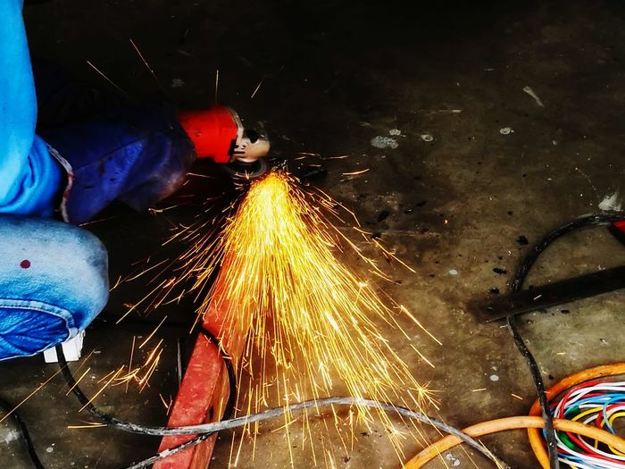 working Metal Industry Arts Culture And Entertainment City Men Multi Colored Sparks Firework Display