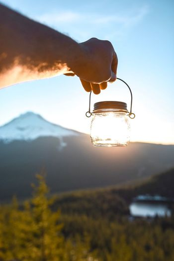Close-up of light bulb on lake against sky
