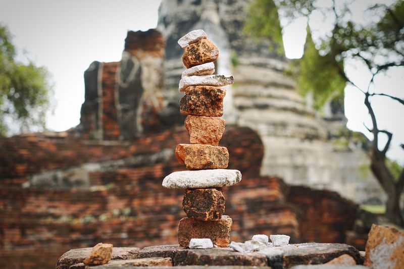 Stack of rocks against old ruin