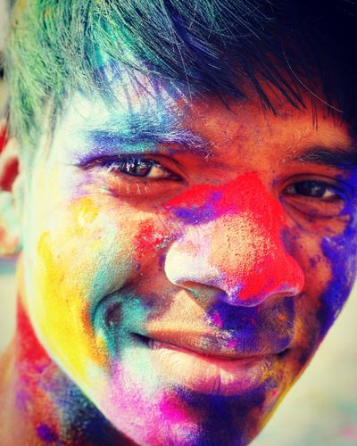 Close-up portrait of young man with powder paint