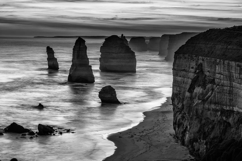 Twelve Apostles rock formations, Great Ocean Road, Victoria, Australia. Black and white image. 12 Apostles Australia Australian Landscape Great Ocean Road Great Views Twelve Apostles Beach Beauty In Nature Black And White Day Horizon Over Water Landscape Nature No People Outdoors Physical Geography Rock - Object Rock Formation Sand Scenics Sea Sky Tranquil Scene Tranquility Water