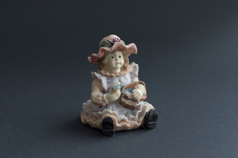 Close-up of figurine against black background