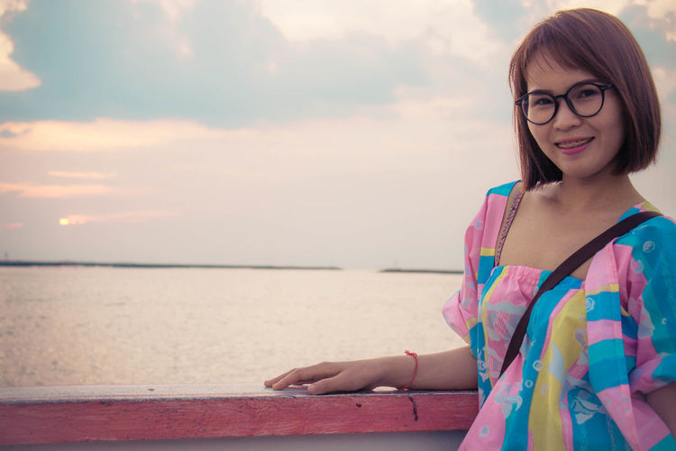 Good Day Beautiful Woman Emotion Eyeglasses  Focus On Foreground Glasses Hairstyle Happiness Leisure Activity Lifestyles Looking At Camera Nature One Person Portrait Real People Sea Sky Smiling Water Women Young Adult Young Women