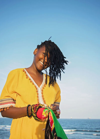 Braids Young Adult Black Girl Beautiful Woman African Beauty Casual Clothing Sky Water Lifestyles Leisure Activity Real People Standing Sea Front View Nature Three Quarter Length Hair Day Happiness Smiling Land Hairstyle Outdoors My Best Photo Toothy Smile International Women's Day 2019 Exploring Fun