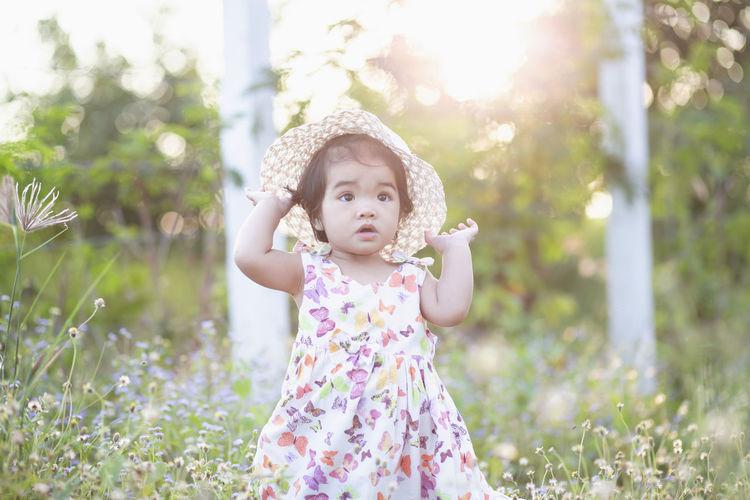 Full length of cute baby girl on field