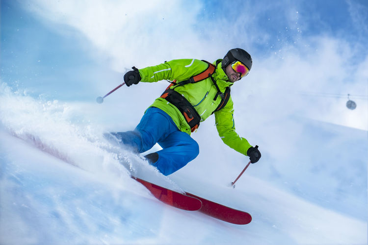 Low angle view of man skiing on ski slope