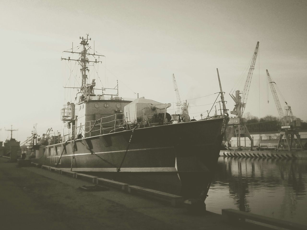 View Of Ship Moored At Commercial Dock Against Sky