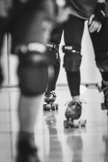 Roller Derby Black And White Bokeh Photography Close-up Indoor Sports Indoors  Low Section Protection Gear Roller Skating Rollerskates Rollerskating