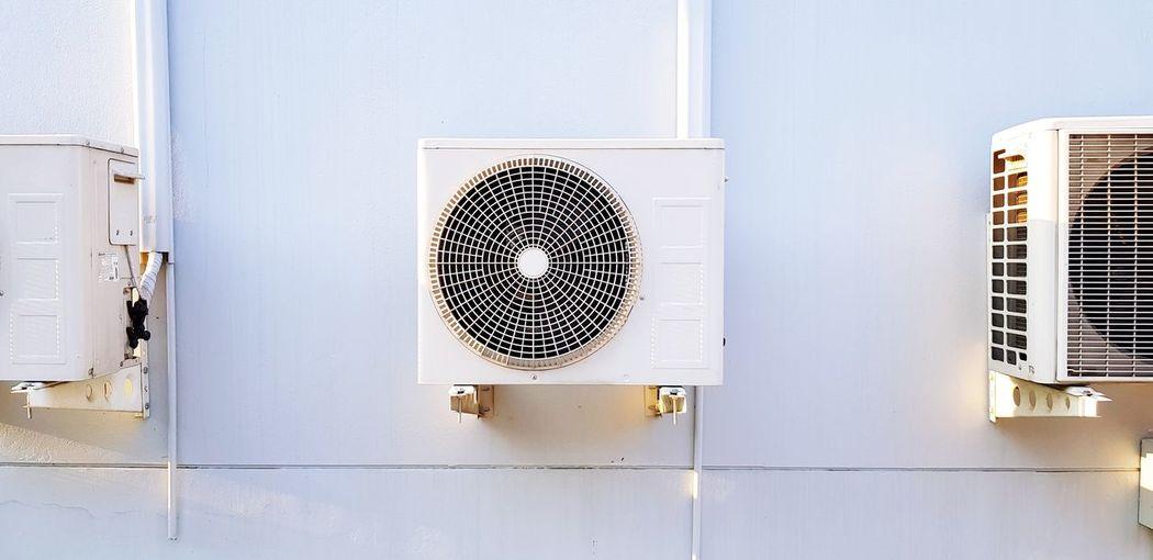 Directly below shot of electric fan on wall