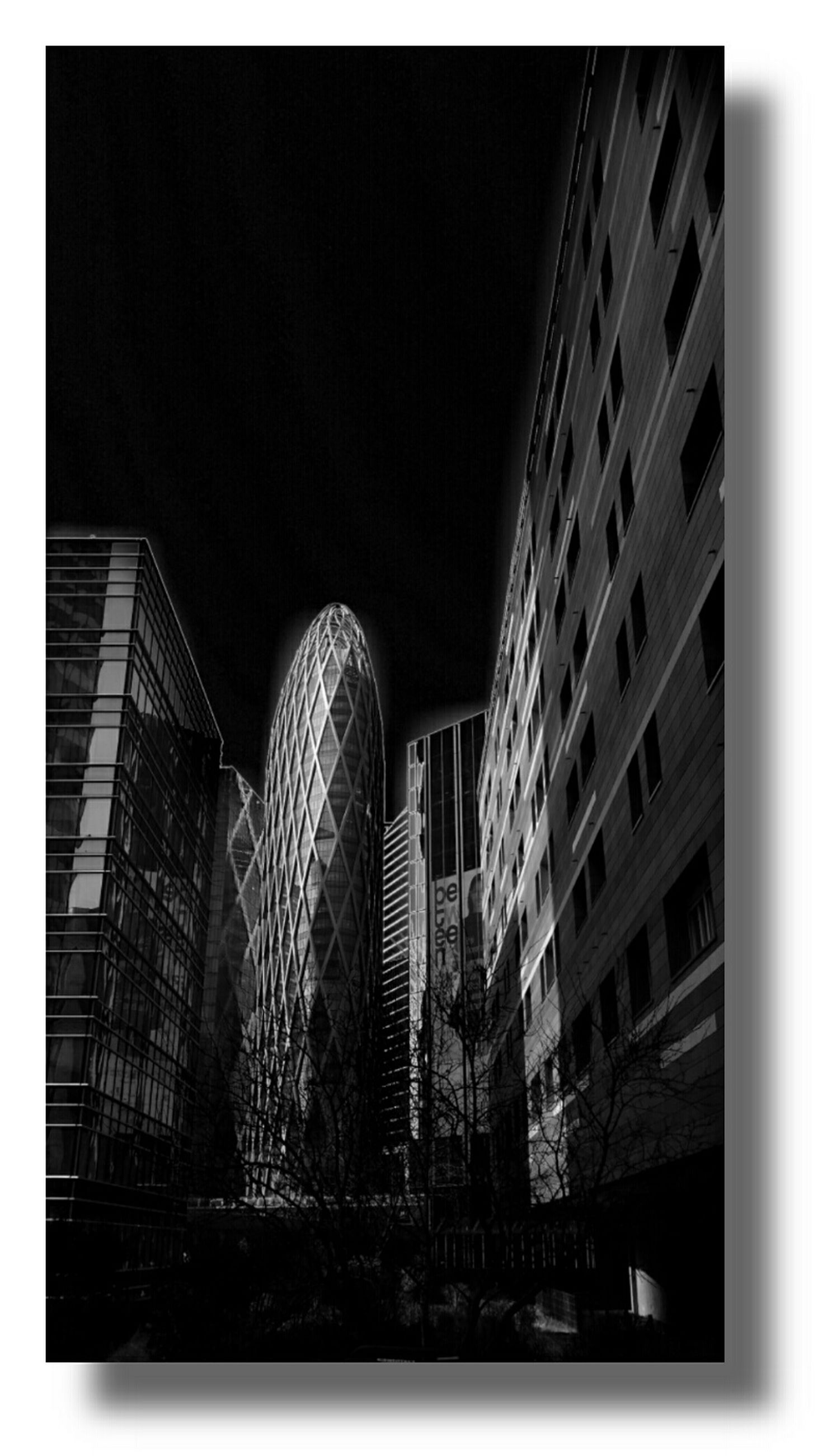transfer print, architecture, auto post production filter, built structure, building exterior, night, low angle view, city, illuminated, building, copy space, clear sky, no people, dark, modern, residential building, outdoors, residential structure, sky, window