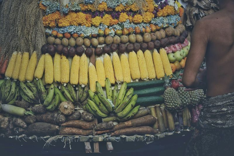 Close-Up Rear View Of Man Selling Fruits