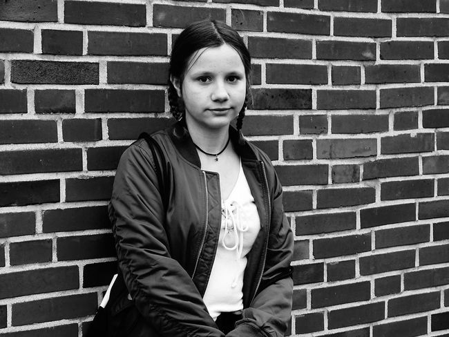 Brick Wall Real People One Person Lifestyles Portrait Front View Standing Outdoors Adults Only Architecture People Young Adult Adult Day Fashion EyeEm Best Shots Only Women EyeEm Gallery Bnw Portrait People Of EyeEm People Photography Girl Girl Portrait Smile Beautiful